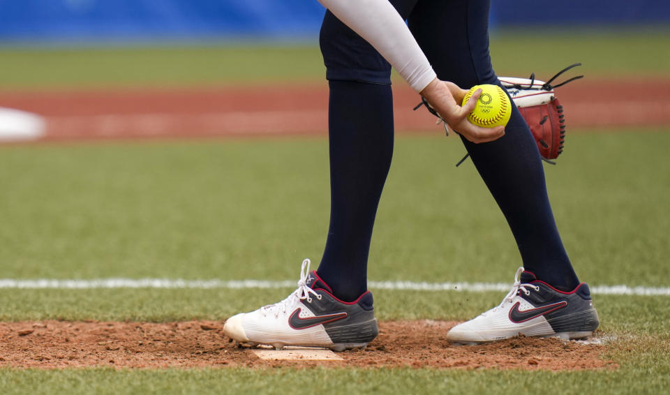 United States' Monica Abbott prepares to pitch during the softball game between the United States and Canada at the 2020 Summer Olympics, Thursday, July 22, 2021, in Fukushima , Japan. (AP Photo/Jae C. Hong)