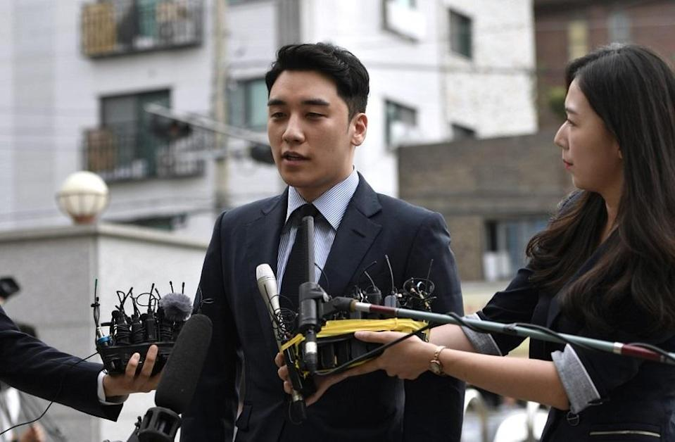 Former BIGBANG member Seungri, real name Lee Seung-hyun, speaks to the media as he arrives for police questioning in Seoul August 28, 2019. — AFP pic