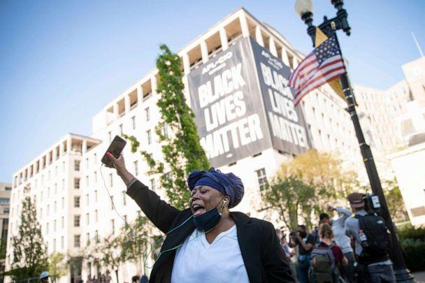 PHOTO: A person celebrates the verdict of the Derek Chauvin trial at Black Lives Matter Plaza near the White House on April 20, 2021, in Washington. (Sarah Silbiger/Getty Images)