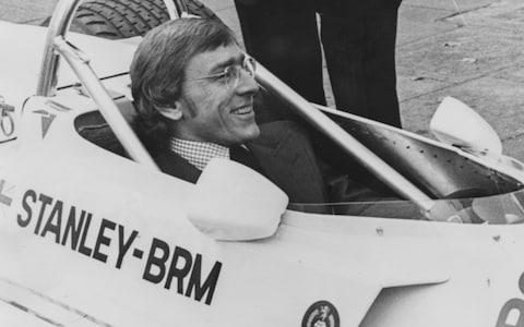 Racing driver Larry Perkins at the wheel of the new Stanley BRM racing car in London - Credit: Hulton Archive