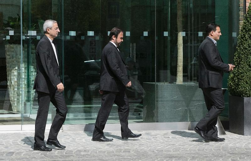 Iran's ambassador to the International Atomic Energy Agency (IAEA) Reza Najafi (centre) leaves Coburg Palace during talks with world powers in Vienna, on April 22, 2015
