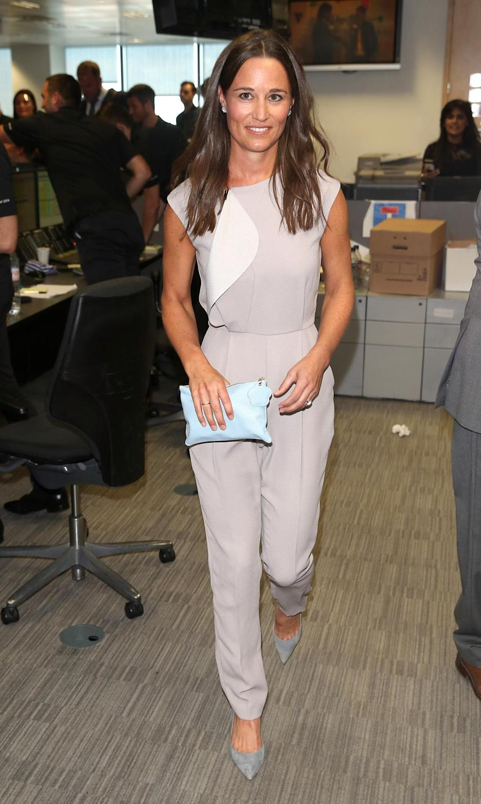 <p>Pippa manned the phones for a charity event wearing a tailored lilac jumpsuit and pointy grey heels. <i>[Photo: Getty]</i> </p>
