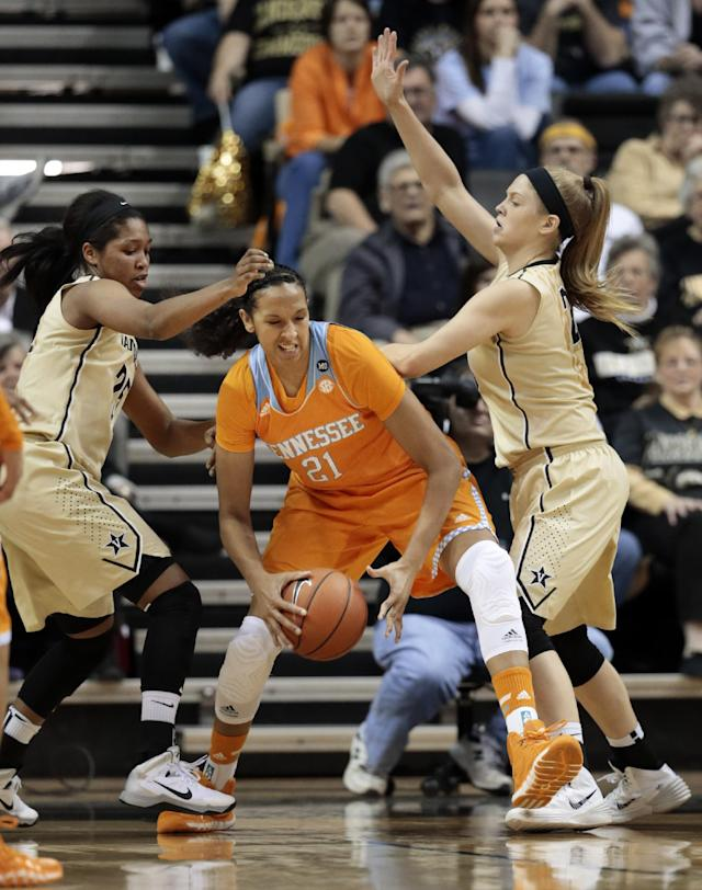 Tennessee center Mercedes Russell (21) tries to get past Vanderbilt defenders Morgan Batey, left, and Kylee Smith, right, in the first half of an NCAA college basketball game on Sunday, Jan. 12, 2014, in Nashville, Tenn. (AP Photo/Mark Humphrey)