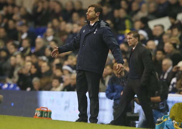 Tottenham's manager Andre Villas-Boas puts his arms out in frustration as he watches his team play during their English Premier League soccer match between Tottenham Hotspur and Liverpool at the White Hart Lane stadium in London Sunday, Dec. 15, 2013. Tottenham lost the game 5-0. (AP Photo/Alastair Grant)