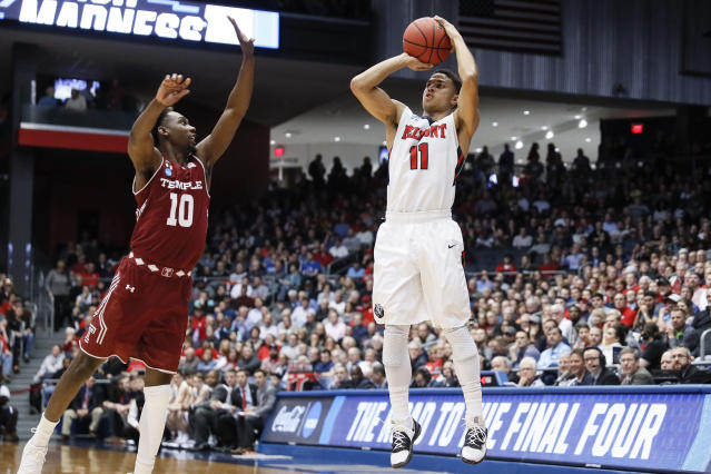 Belmont's Kevin McClain (11) shoots over Temple's Shizz Alston Jr. (10) during the first half of a First Four game of the NCAA college basketball tournament, Tuesday, March 19, 2019, in Dayton, Ohio. (AP Photo/John Minchillo)