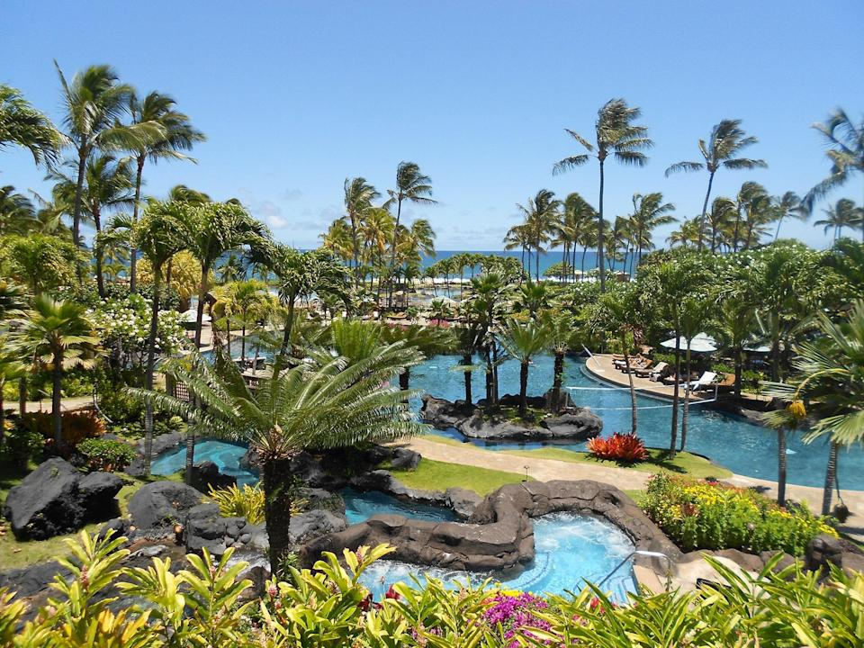 """<p>Though its lava-rock lined pools, saltwater lagoon, and 150-foot waterslide are more than enough to keep kids busy, the <a href=""""https://www.cntraveler.com/hotels/united-states/koloa/grand-hyatt-kauai-resort-and-spa?mbid=synd_yahoo_rss"""" rel=""""nofollow noopener"""" target=""""_blank"""" data-ylk=""""slk:Grand Hyatt Resort and Spa Kauai"""" class=""""link rapid-noclick-resp"""">Grand Hyatt Resort and Spa Kauai</a> also offers engaging activities, like ukulele lessons, lei making, hula dancing and koi fish feeding, to name a few. The resort's Camp Hyatt kids' club, for kids aged three to 12, has a cultural element as well, teaching Hawaiian stories through art and activities. Children will even have a chance to interact with the resort's four resident parrots.</p> <p>Though standard guest rooms are large—two queen beds make it easy to sleep a family of four in one—the suites start at 1,055 square feet, with huge dining tables, and wraparound private balconies. Dining options for the whole family are expansive as well: the """"For Kids, By Chefs"""" Ilima Terrace menu has been designed, taste-tested, and approved by kids; while moms and dads can look forward to date night at Tidepools, a thatch-roofed bungalow at the base of a waterfall (the macadamia-crusted Mahi Mahi is a must-order).</p> <p><strong>Book now:</strong> From $499 per night, <a href=""""https://cna.st/affiliate-link/Bmaj1V9t4nDfMf7AwtuLqibuvBt74LsG7BbZXDXtZpYdNkhawWW1Yu1MnXGKHQB7GaxzXdGvop9J8oQ31UJCBN6geyKAp6btuokV2X51z6ZBJjBfs5gyXn3MsPuAWSBqaq9tz7bohCuBFgNTZMRr4eg4upruEAVkaQheZXCh?cid=5509909e481a91bb781a0027"""" rel=""""nofollow noopener"""" target=""""_blank"""" data-ylk=""""slk:expedia.com"""" class=""""link rapid-noclick-resp"""">expedia.com</a></p>"""