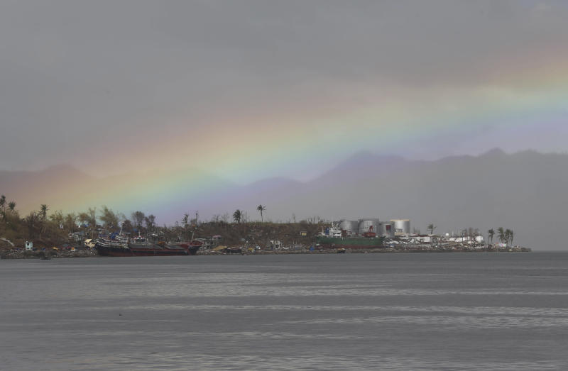 A rainbow rises along damaged homes in Tacloban city, Leyte province, central Philippines Tuesday, Nov. 19, 2013. Hundreds of thousands of people were displaced by Typhoon Haiyan, which tore across several islands in the eastern Philippines on Nov. 8. (AP Photo/Aaron Favila)