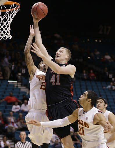 Utah's Jeremy Olsen (41) goes up for a shot against USC's J.T. Terrell, left, and Aaron Fuller in the first half during a Pac-12 tournament NCAA college basketball game on Wednesday, March 13, 2013, in Las Vegas. (AP Photo/Julie Jacobson)
