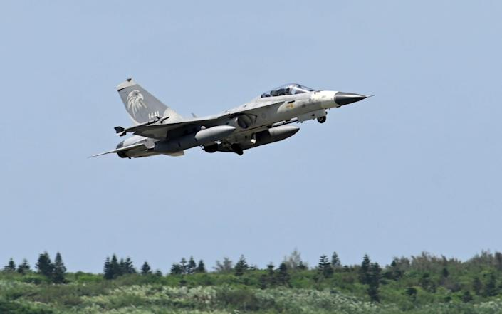 A Taiwanese fighter jet takes off from Penghu Air Force Base - Sam Yeh/AFP