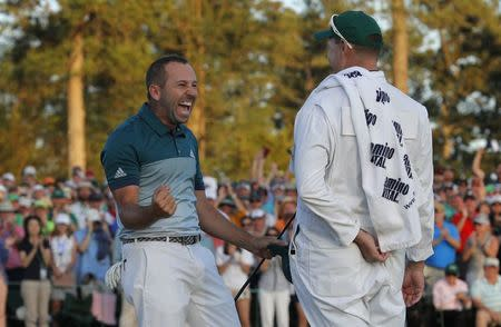 Sergio Garcia of Spain celebrates winning the Masters with caddie Glenn Murray during a playoff against Justin Rose of England in the final round of the 2017 Masters golf tournament at Augusta National Golf Club in Augusta, Georgia, U.S., April 9, 2017. REUTERS/Mike Segar