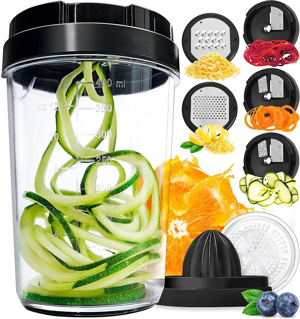 """It cangrate cheese, juice fruits, cut ribbon and so much more. This lil' gadget really does it all.<br /><br /><strong>Promising review:</strong>""""I recently purchased this because it was my cheapest option for making zoodles, and also because my apartment is the size of a shoebox and there was no room for anything bigger.<strong>I LOVE how easy it is to swap out the caps</strong>to do other things, too — I've started grating my own cheeses and feel very fancy. But mostly I just love that<strong>it's very safe to use (it comes with a finger guard!), super easy to figure out, very compact</strong>, and even has measurements on the inside of the cup if you're ever portioning things out for a recipe."""" —<a href=""""https://www.buzzfeed.com/emmalord9"""" target=""""_blank"""" rel=""""noopener noreferrer"""">Emma Lord</a><br /><br /><strong>Get it from Amazon for <a href=""""https://www.amazon.com/dp/B07Y2B97VX?tag=huffpost-bfsyndication-20&ascsubtag=5817703%2C13%2C43%2Cd%2C0%2C0%2C0%2C962%3A1%3B901%3A2%3B900%3A2%3B974%3A3%3B975%3A2%3B982%3A2%2C16176010%2C0"""" target=""""_blank"""" rel=""""noopener noreferrer"""">$14.99</a>.</strong>"""