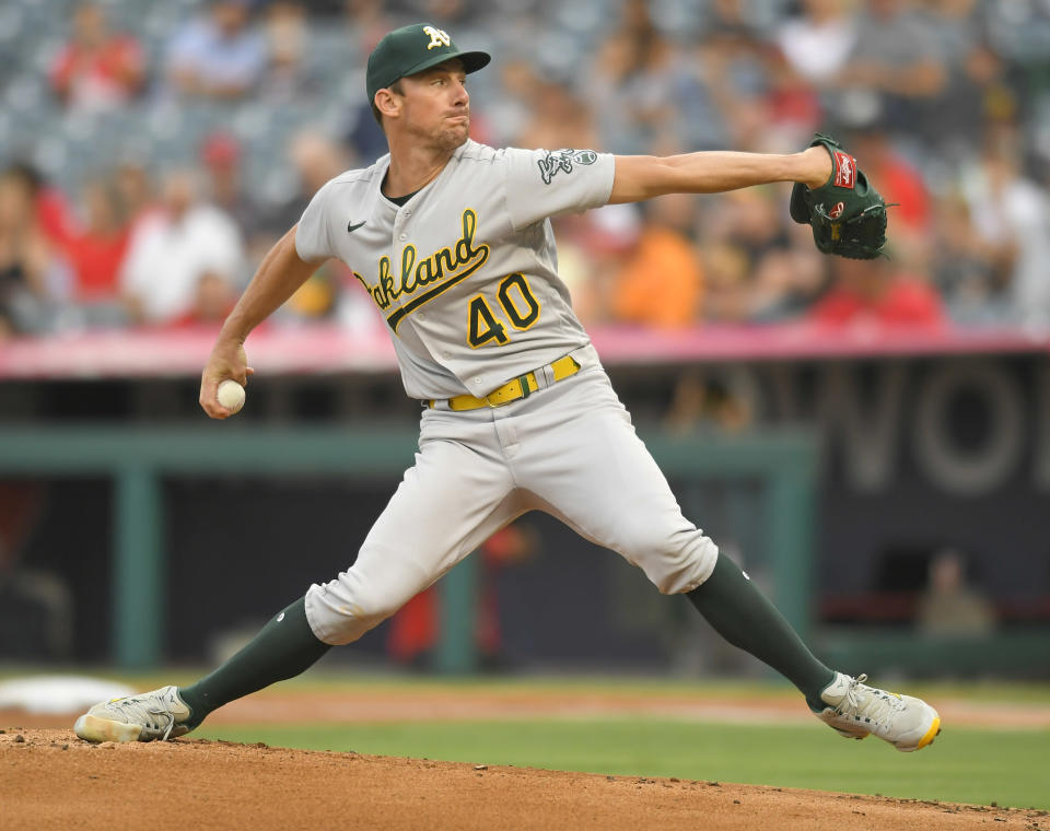 Oakland Athletics starting pitcher Chris Bassitt throws during the first inning of the team's baseball game against the Los Angeles Angels on Friday, July 30, 2021, in Anaheim, Calif. (AP Photo/John McCoy)