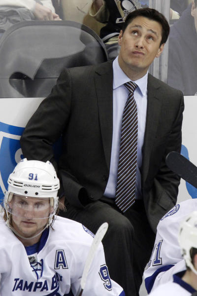 FILE - In this Saturday, Feb. 25, 2012 file photo, Tampa Bay Lightning coach Guy Boucher stands behind Steven Stamkos (91) in the third period of an NHL hockey game against the Pittsburgh Penguins in Pittsburgh. The Tampa Bay Lightning fired Boucher on Sunday, March 24, 2013. (AP Photo/Gene J. Puskar, File)