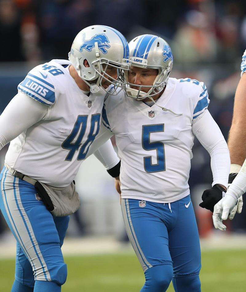Lions punter Jack Fox, right, with Lions kicker Matt Prater, leads the NFL in net yards per punt.