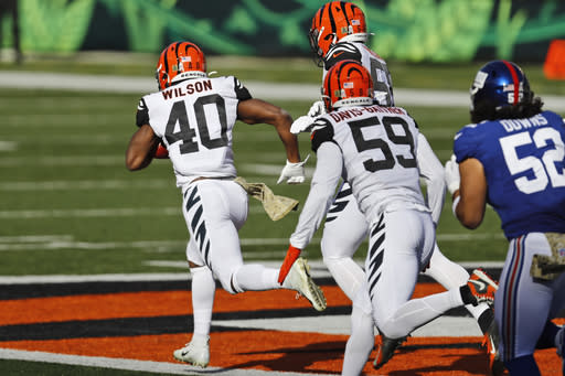 Cincinnati Bengals safety Brandon Wilson (40) rushes for a 103-yard touchdown during the first half of NFL football game against the New York Giants, Sunday, Nov. 29, 2020, in Cincinnati. (AP Photo/Aaron Doster)