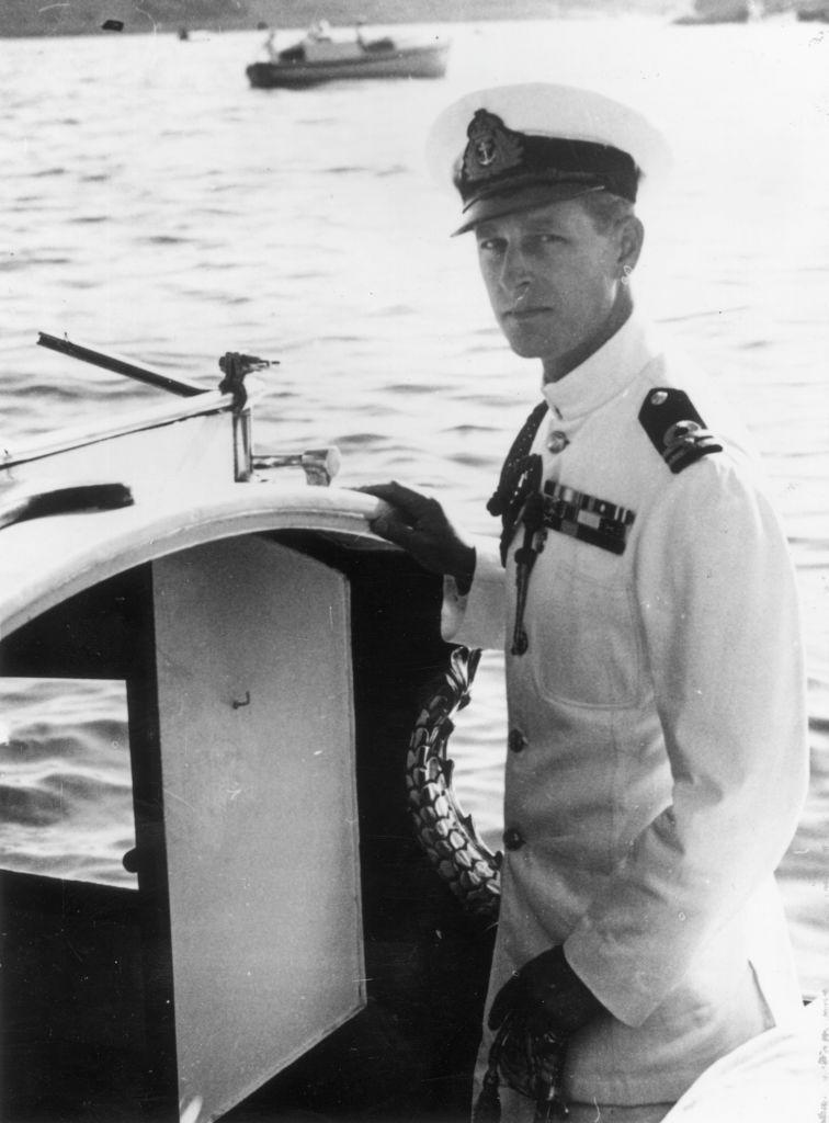 <p>The Duke of Edinburgh in naval uniform on a boat in Malta.</p>