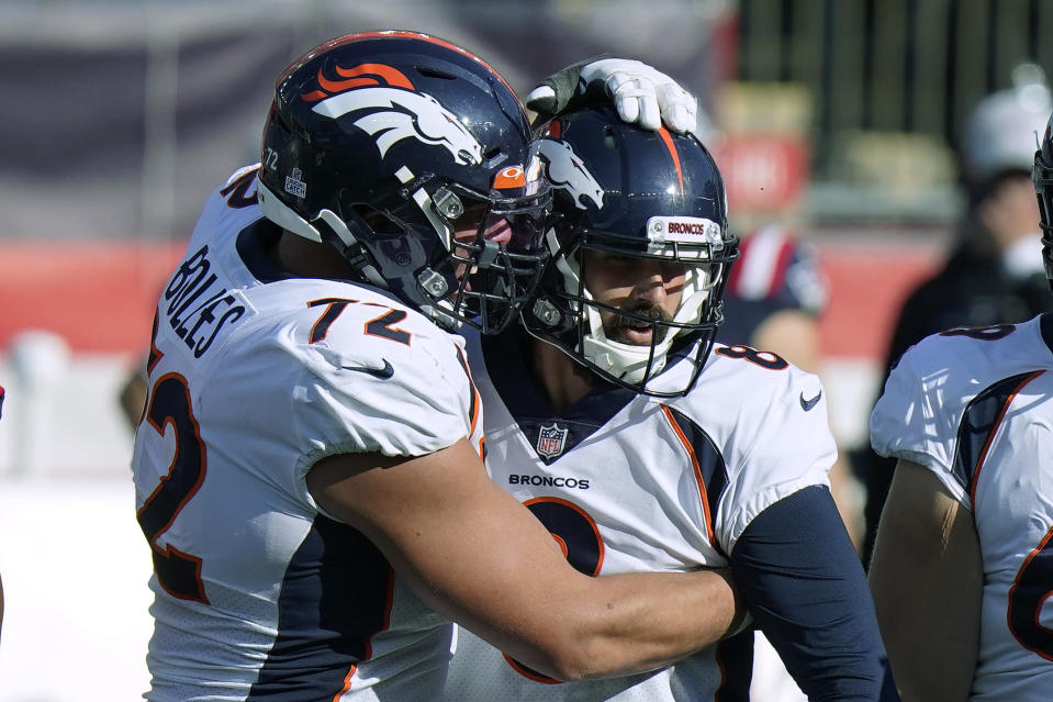 Denver Broncos offensive tackle Garett Bolles, left, congratulates kicker Brandon McManus in the second half of an NFL football game after his sixth field goal against the New England Patriots, Sunday, Oct. 18, 2020, in Foxborough, Mass. (AP Photo/Steven Senne)