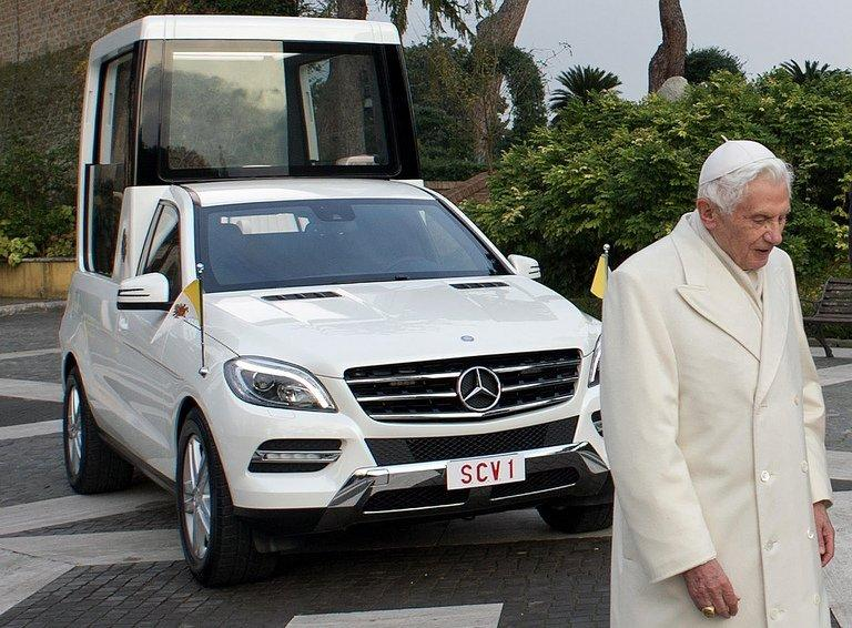 "Pope Benedict XVI stands next to the new Mercedes-Benz ""popemobile"""