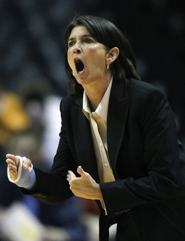 FILE - In this Jan. 5, 2012, file photo, Tennessee assistant coach Mickie DeMoss yells to her team in the second half of an NCAA women's college basketball game against Georgia, in Knoxville, Tenn. Connecticut assistant coach Chris Dailey and former Tennessee assistant Mickie DeMoss are breaking new ground this weekend when they get inducted into the Women's Basketball Hall of Fame. This marks the first time in the organization's 20-year history that it has inducted anyone based on accomplishments as an assistant coach. (AP Photo/Wade Payne, File)