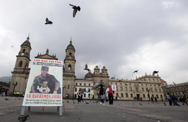 A poster with an image of missing army sergeant Hector Velasquez sits at the Bolivar's square during a protest organized by activists and relatives of people allegedly disappeared by rebels, in Bogota, Colombia, Sunday, Oct. 14, 2012. Demonstrators demanded participation in the peace talks between Colombia's government and Colombia's main leftist rebel movement, FARC, that will start on Monday in Norway. (AP Photo/Fernando Vergara)