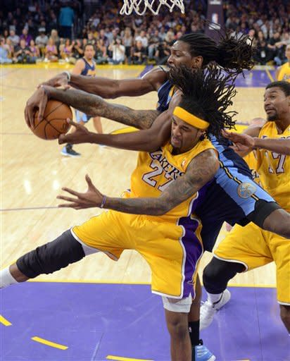 Denver Nuggets forward Kenneth Faried, top, and Los Angeles Lakers center Jordan Hill battle for a rebound during the first half of Game 7 in their first-round NBA basketball playoff series, Saturday, May 12, 2012, in Los Angeles. (AP Photo/Mark J. Terrill)