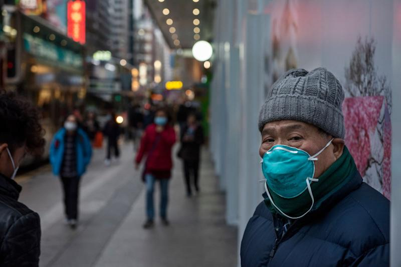 HONG KONG, CHINA - 2020/01/28: A man with a face mask to prevent infections in Hong Kong. Since the spread of the corona virus, the death stands at 106, with the number of infections almost doubling in a day to more than 4,500. (Photo by Miguel Candela/SOPA Images/LightRocket via Getty Images)