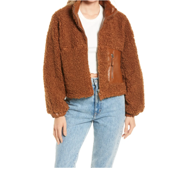 Model wears BlankNYC Faux Shearling with Faux Leather Trim Bomber Jacket in brown