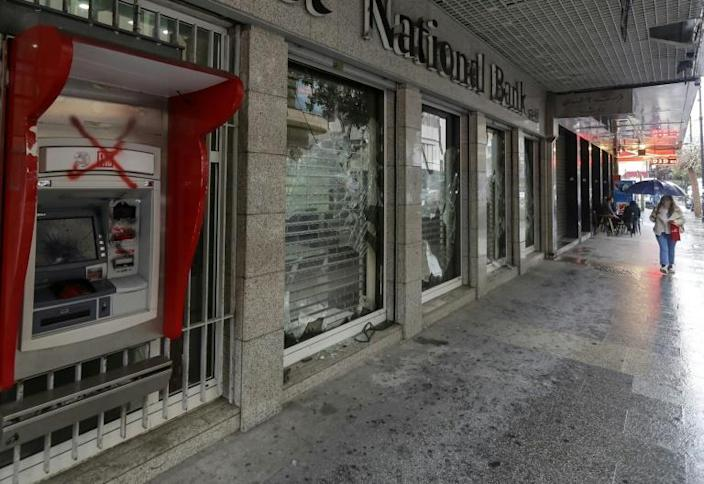 Banks have been vandalised as people vent against withdrawal restrictions (AFP Photo/JOSEPH EID)