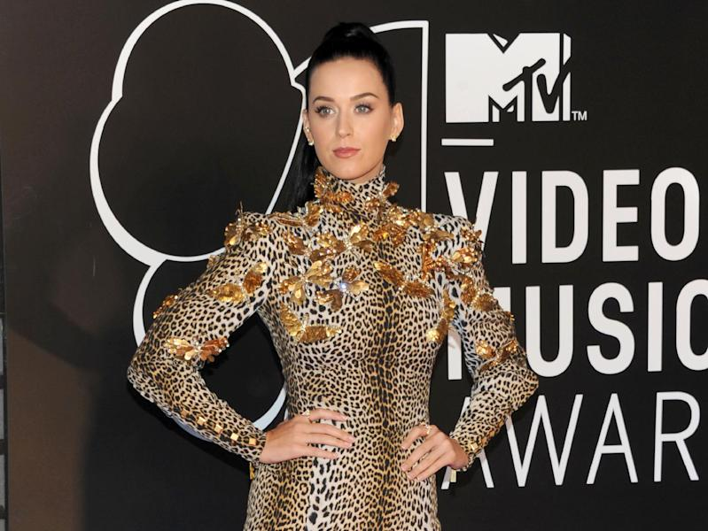 "FILE - This Aug. 25, 2013 file photo shows Katy Perry at the MTV Video Music Awards in the Brooklyn borough of New York. Perry says though she's ""older and wiser,"" she still plans to have fun on her new album. Perry debuted 12 songs from ""Prism"" in front of an audience of 100 industry insiders and journalists Thursday, Sept. 5, in New York. (Photo by Evan Agostini/Invision/AP, File)"