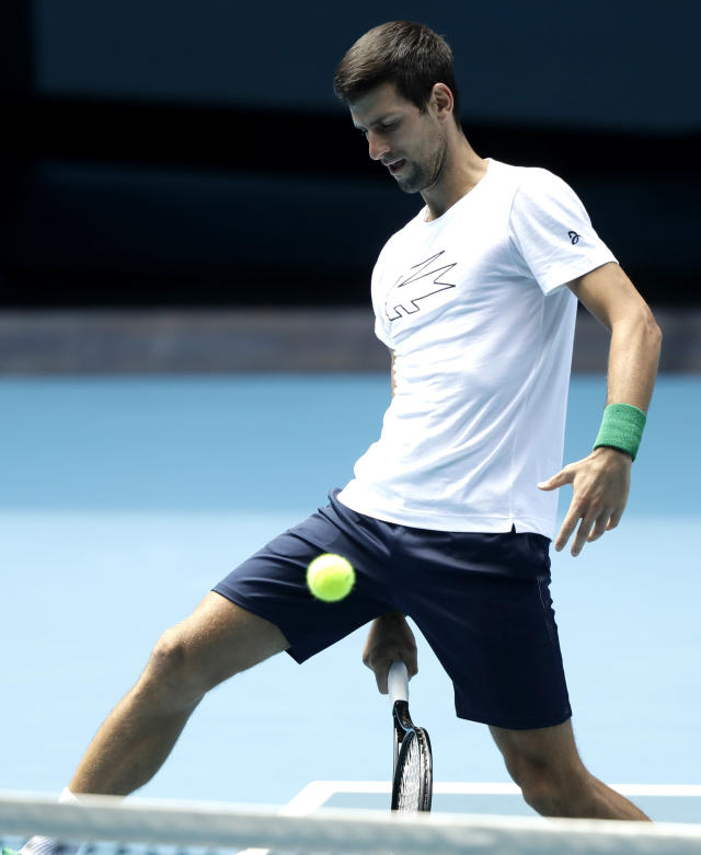 Serbia's Novak Djokovic hits the ball during a practice session on Rod laver Arena ahead of the Australian Open tennis championship in Melbourne, Australia, Thursday, Jan. 16, 2020. (AP Photo/Mark Baker)