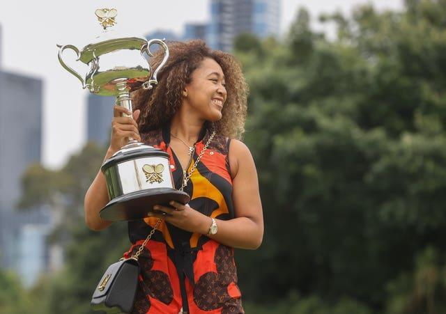 Naomi Osaka poses with the Daphne Akhurst Memorial Cup