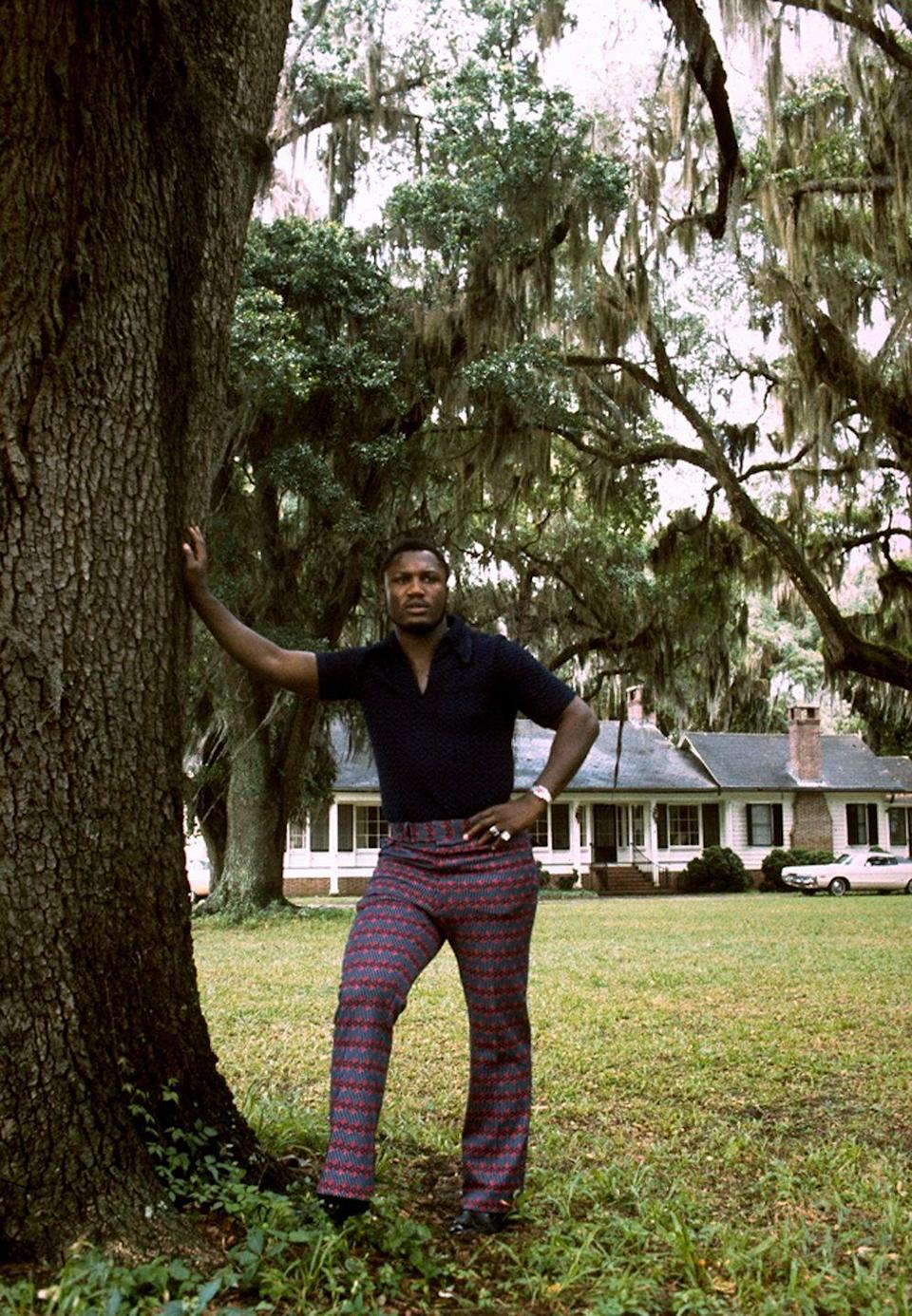 <p>Professional boxer Joe Frazier poses on the front lawn of his home in Yemassee, South Carolina in 1972.</p>