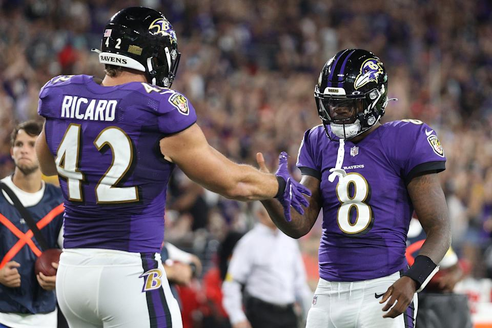 Lamar Jackson of the Baltimore Ravens celebrates with Patrick Ricard #42 after a rushing touchdown against the Kansas City Chiefs during the fourth quarter at M&T Bank Stadium on September 19, 2021 in Baltimore, Maryland.