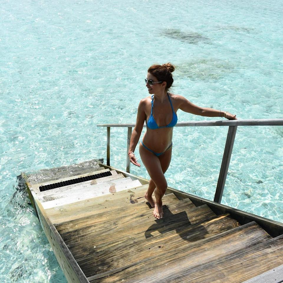 <p>She's shown off her incredible bikini figure with a photo of her gazing across the crystal clear water. Not jealous at all… Source: Instagram/Ada Nicodemou </p>