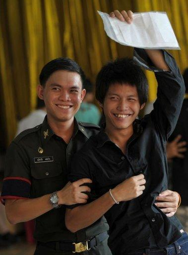 AThai youth celebrates after he was not selected during a selection process to pick military recruits - through a lottery system - held at a temple grounds in Bangkok. By law all Thai men who do not volunteer for military service must attend the conscription lottery at least once after they turn 21