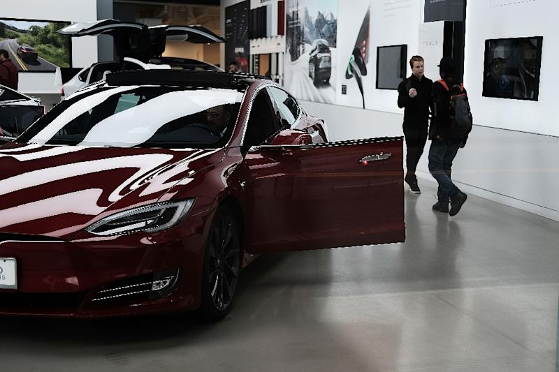 Elon Musk faces pressure over ramping up production of Teslas to meet consumer demand (AFP Photo/SPENCER PLATT)
