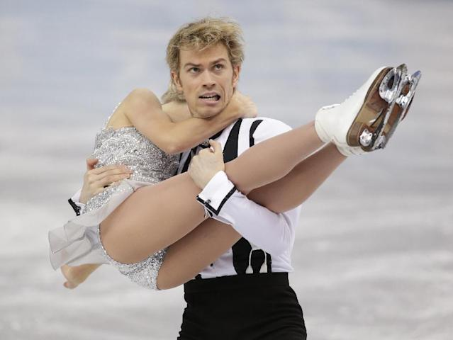 Penny Coomes and Nicholas Buckland of Britain compete in the ice dance short dance figure skating competition at the Iceberg Skating Palace during the 2014 Winter Olympics, Sunday, Feb. 16, 2014, in Sochi, Russia. (AP Photo/Bernat Armangue)