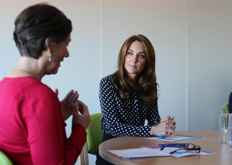 Britain's Catherine, Duchess of Cambridge chats during her visit to the Sunshine House Children and Young People's Health and Development Centre to meet with the Southwark Family Nurse Partnership team and highlight their valuable work, in Peckham, south London on September 19, 2019. (Photo by Ian Vogler / POOL / AFP) (Photo credit should read IAN VOGLER/AFP/Getty Images)