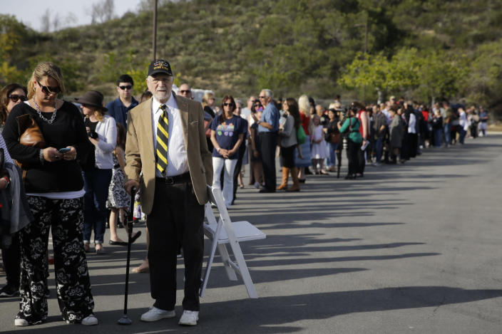 <p>People wait in line to board buses to take them to the Ronald Reagan Presidential Library for the public viewing of former first lady Nancy Reagan, on Wednesday, March 9, 2016, in Simi Valley, Calif. <i>(Photo:Jae C. Hong/AP)</i></p>