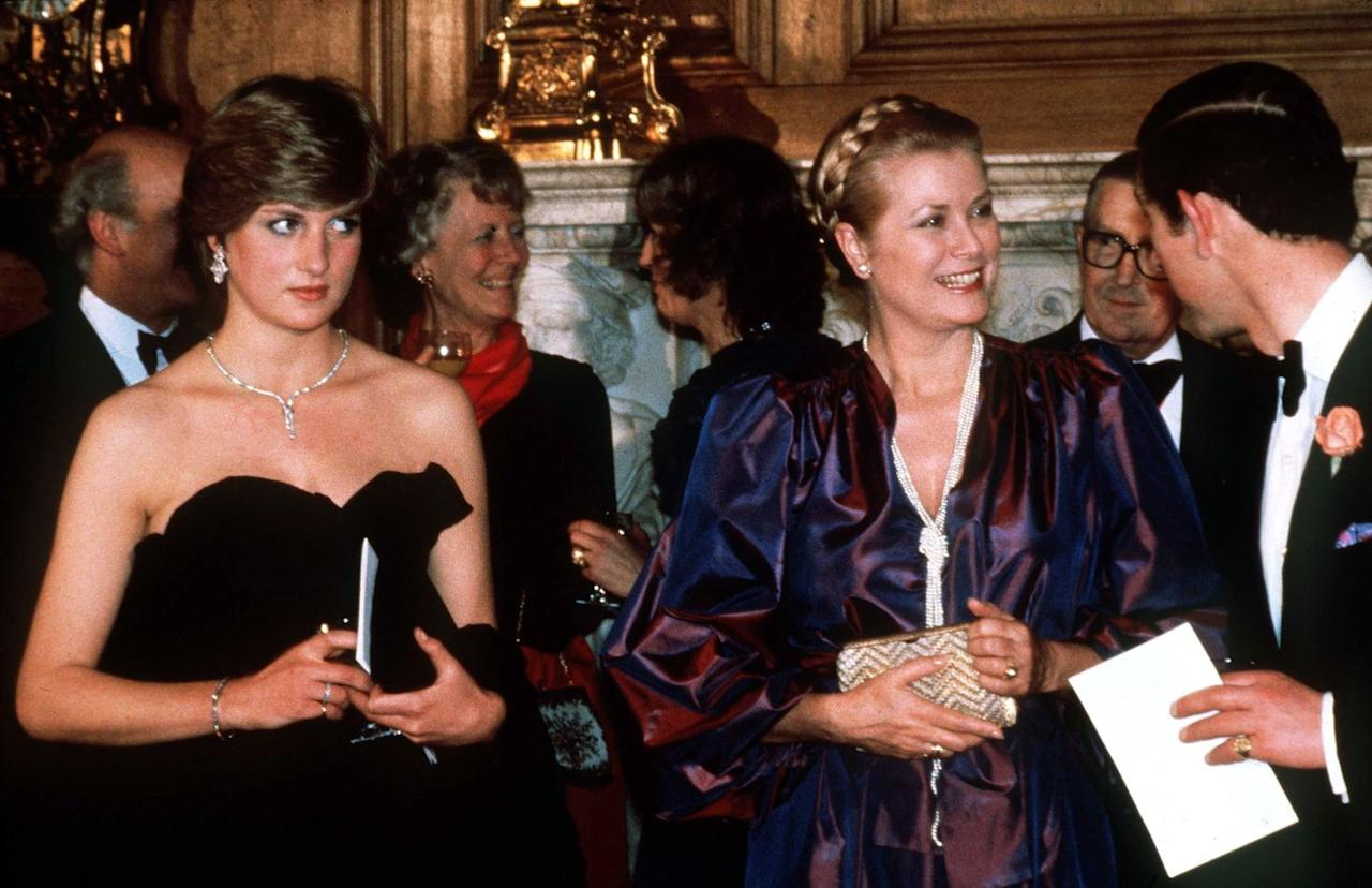 <p>The Princess of Monaco met Princess Diana at a fundraising event for the Royal Opera in London and wore a plum dress with balloon sleeves and a statement pearl necklace for the occasion.</p>