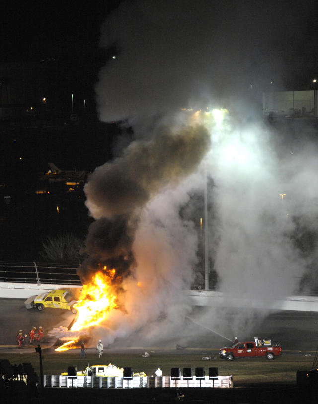 Flames shoot up from burning fuel from a jet dryer after Juan Pablo Montoya's car collided with the dryer during a caution in the NASCAR Daytona 500 auto race at Daytona International Speedway in Daytona Beach, Fla., Monday, Feb. 27, 2012. (AP Photo/Phelan M. Ebenhack)