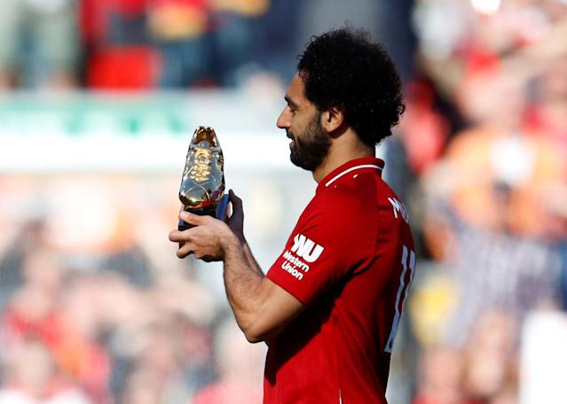 "Soccer Football - Premier League - Liverpool vs Brighton & Hove Albion - Anfield, Liverpool, Britain - May 13, 2018 Liverpool's Mohamed Salah celebrates with the Golden Boot after the match REUTERS/Phil Noble EDITORIAL USE ONLY. No use with unauthorized audio, video, data, fixture lists, club/league logos or ""live"" services. Online in-match use limited to 75 images, no video emulation. No use in betting, games or single club/league/player publications. Please contact your account representative for further details."