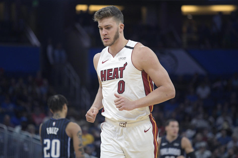 Miami Heat forward Meyers Leonard (0) runs up the court after a play during the first half of an NBA basketball game against the Orlando Magic Friday, Jan. 3, 2020, in Orlando, Fla. (AP Photo/Phelan M. Ebenhack)
