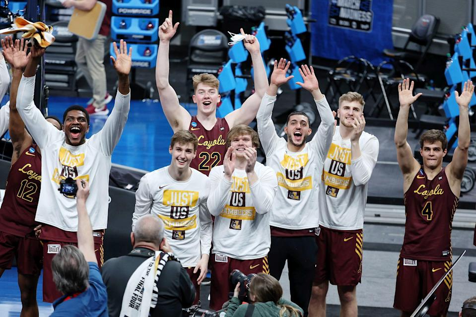 The Loyola Ramblers point to Sister Jean after defeating Illinois in the second round of the NCAA Tournament.