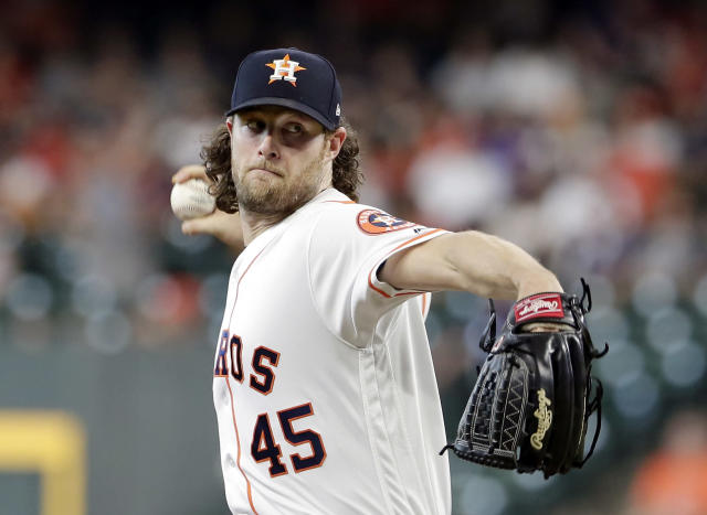 Houston Astros starting pitcher Gerrit Cole (45) throws during the first inning of a baseball game against the Colorado Rockies Wednesday, August 7, 2019, in Houston. (AP Photo/Michael Wyke)
