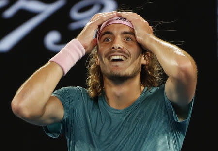 Tennis - Australian Open - Fourth Round - Melbourne Park, Melbourne, Australia, January 20, 2019. Greece's Stefanos Tsitsipas reacts after winning the match against Switzerland's Roger Federer. REUTERS/Adnan Abidi
