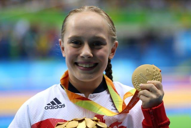 Ellie Robinson with her gold medal from the Rio 2016 Paralympics (Andrew Matthews/PA).