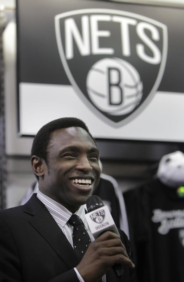Brooklyn Nets basketball coach Avery Johnson speaks during a news conference to unveil the new team logo, in the Brooklyn borough of New York, Monday, April 30, 2012. The Nets will be moving from New Jersey to the new Barclays Center in Brooklyn, New York for the 2012-2013 NBA basketball season. (AP Photo/Seth Wenig)