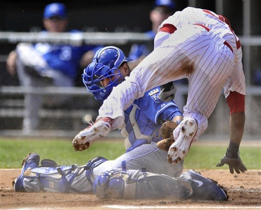 Kansas City Royals catcher Salvador Perez, left, tags out Chicago White Sox's Alejandro De Aza, right, at home plate after De Aza tagged up at third base on a Dewayne Wise pop-up in the first inning during a baseball game in Chicago, Sunday, Sept. 9, 2012. (AP Photo/Paul Beaty)