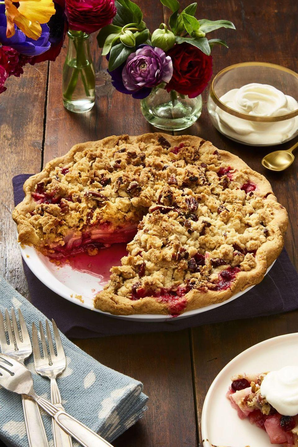 """<p>Ginger, tangerine zest, pears and cranberries make a spicy filling, while a classic buttery crumb topping gets extra richness and crunch from pecans.</p><p><em><a href=""""https://www.womansday.com/food-recipes/food-drinks/a24184810/cranberry-pear-pecan-crumb-pie-recipe/"""" rel=""""nofollow noopener"""" target=""""_blank"""" data-ylk=""""slk:Get the recipe from Woman's Day »"""" class=""""link rapid-noclick-resp"""">Get the recipe from Woman's Day »</a></em></p>"""